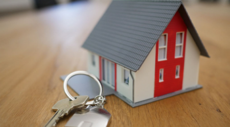 small house figurine with keys